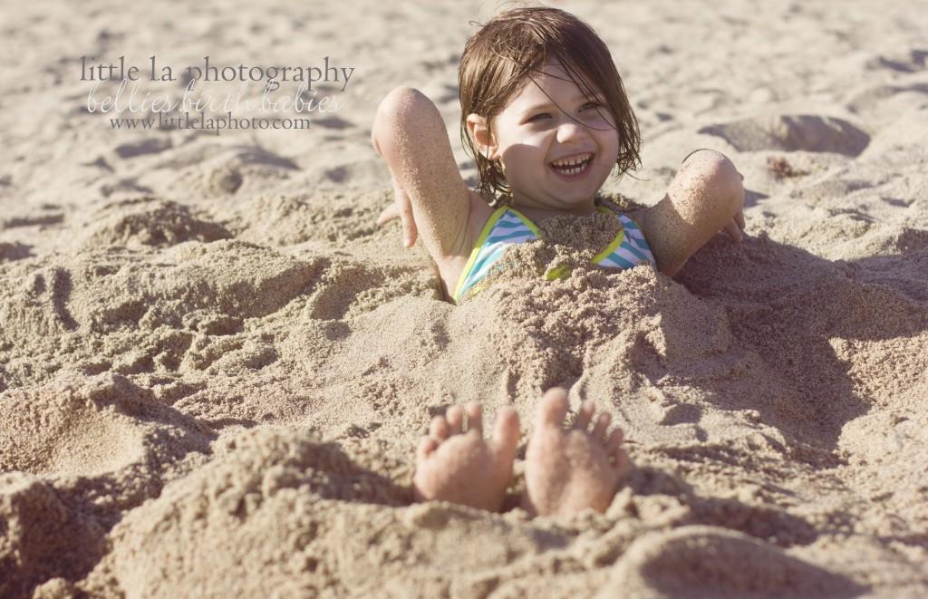 babies playing in sand at beach in santa monica long beach la